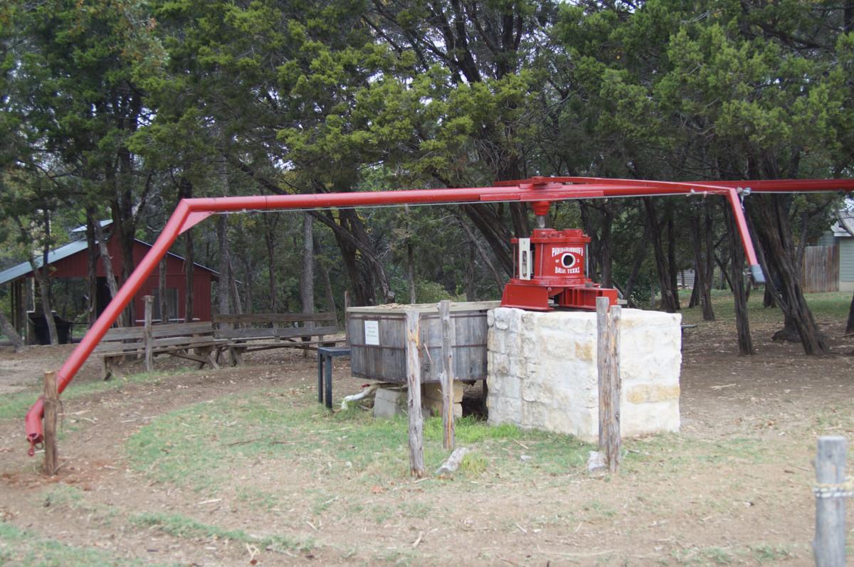 An animal-powered sweet sorghum mill.
