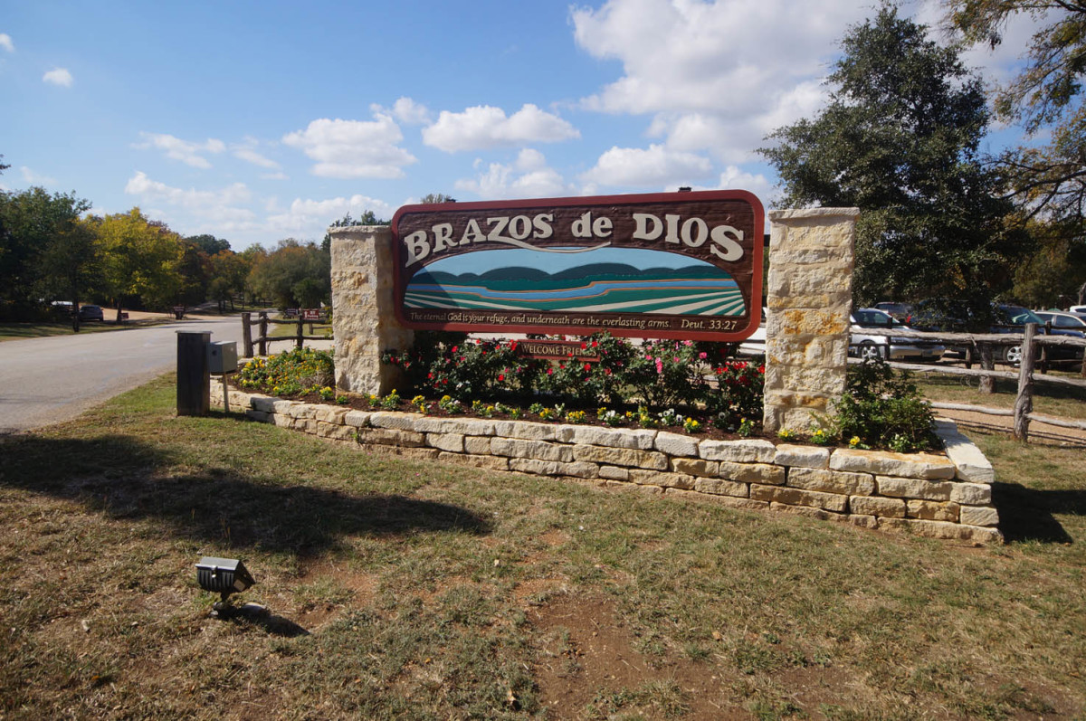 "The entrance to the Homestead Heritage village, where a restaurant, craft store and workshops are all nearby. ""Brazos de Dios"" is Spanish for ""the arms of God,"" a name given to the Waco area describing the rivers that meet here."
