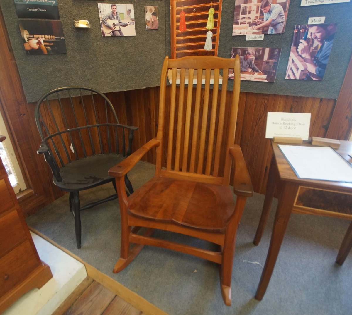 A Windsor chair is featured to the left.  The other rocking chair style is unknown.