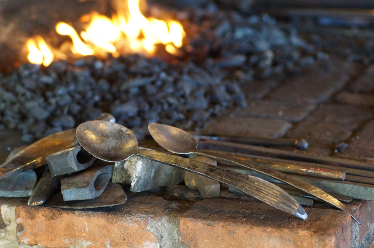 Finished spoons and axe heads made at the Homestead Heritage forge.