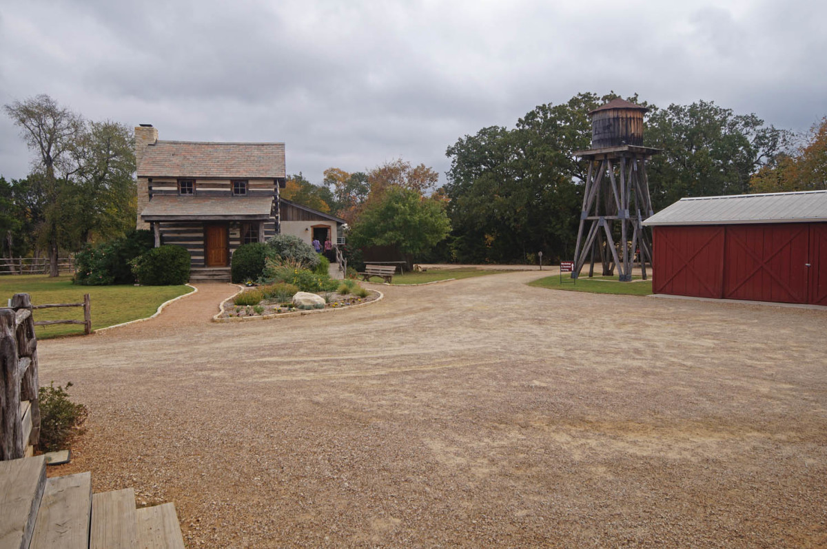 A model homestead that has its own water tower, a silo, two barns, a smokehouse and a garden with poultry pens.  There is also a room to see a video about the community with this area.