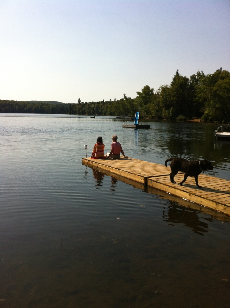 Relaxing on the dock at a rented cottage in Muskoka.