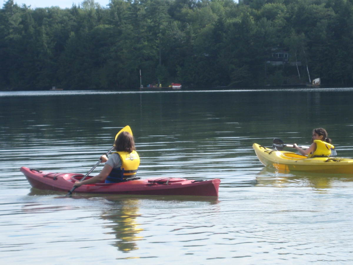 Kayaking on Clear Lake, south of Bala, Ontario.