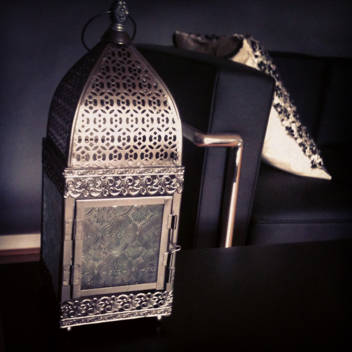 Whether they're situated inside or outside- A Morrocan Lantern can really add a Moorish charm to a room- Whether it's a bachelor pad (pictured) or family home