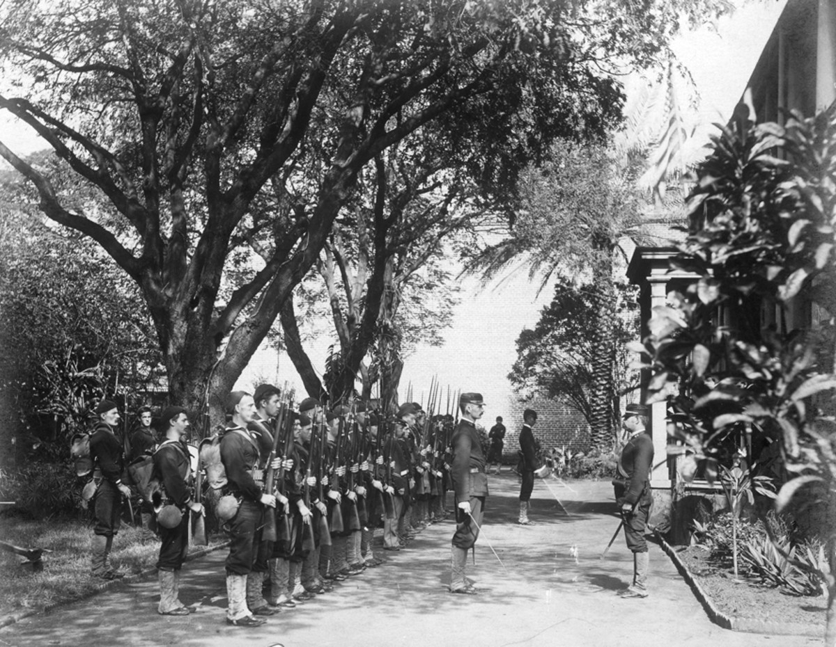 The USS Boston's landing force on duty at the Arlington Hotel, Honolulu, at the time of the overthrow of the Hawaiian monarchy, January 1893.
