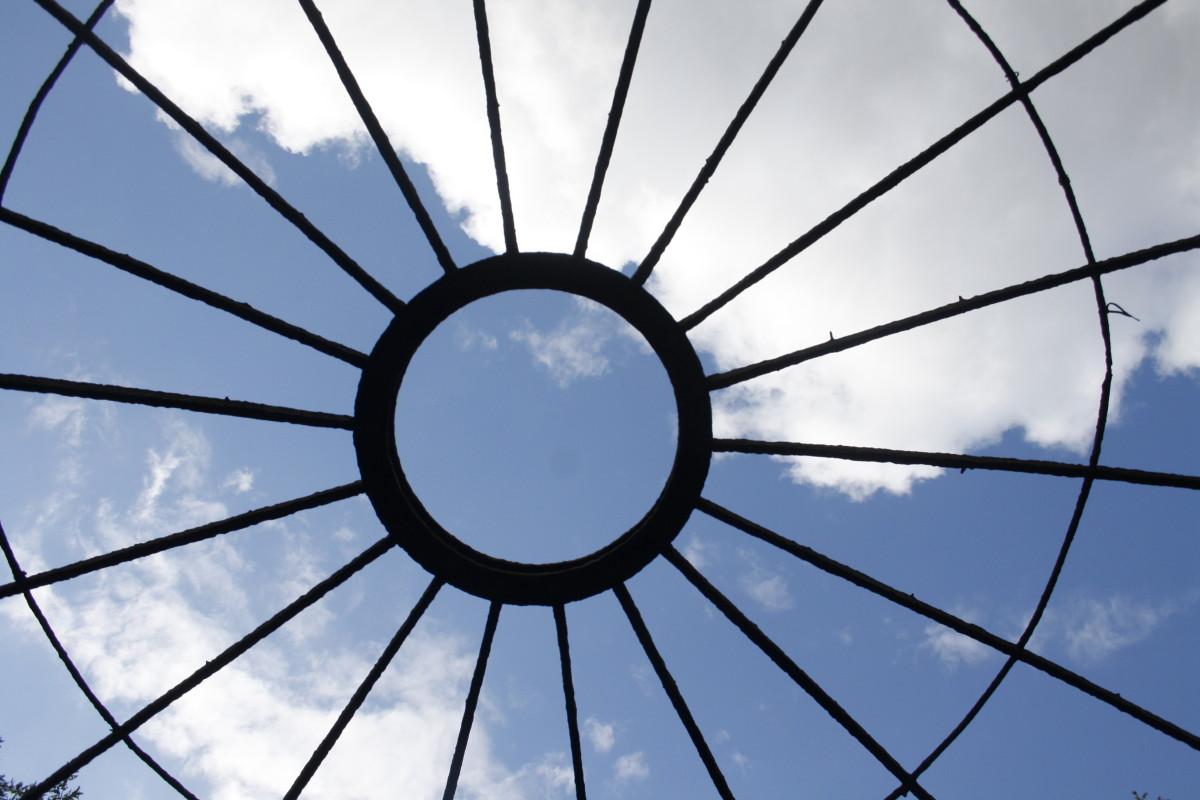 Sky through radiant wheel.