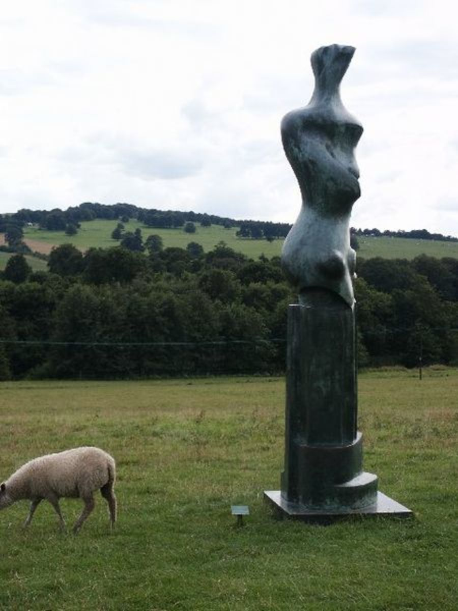 Sheep with Henry Moore sculpture.