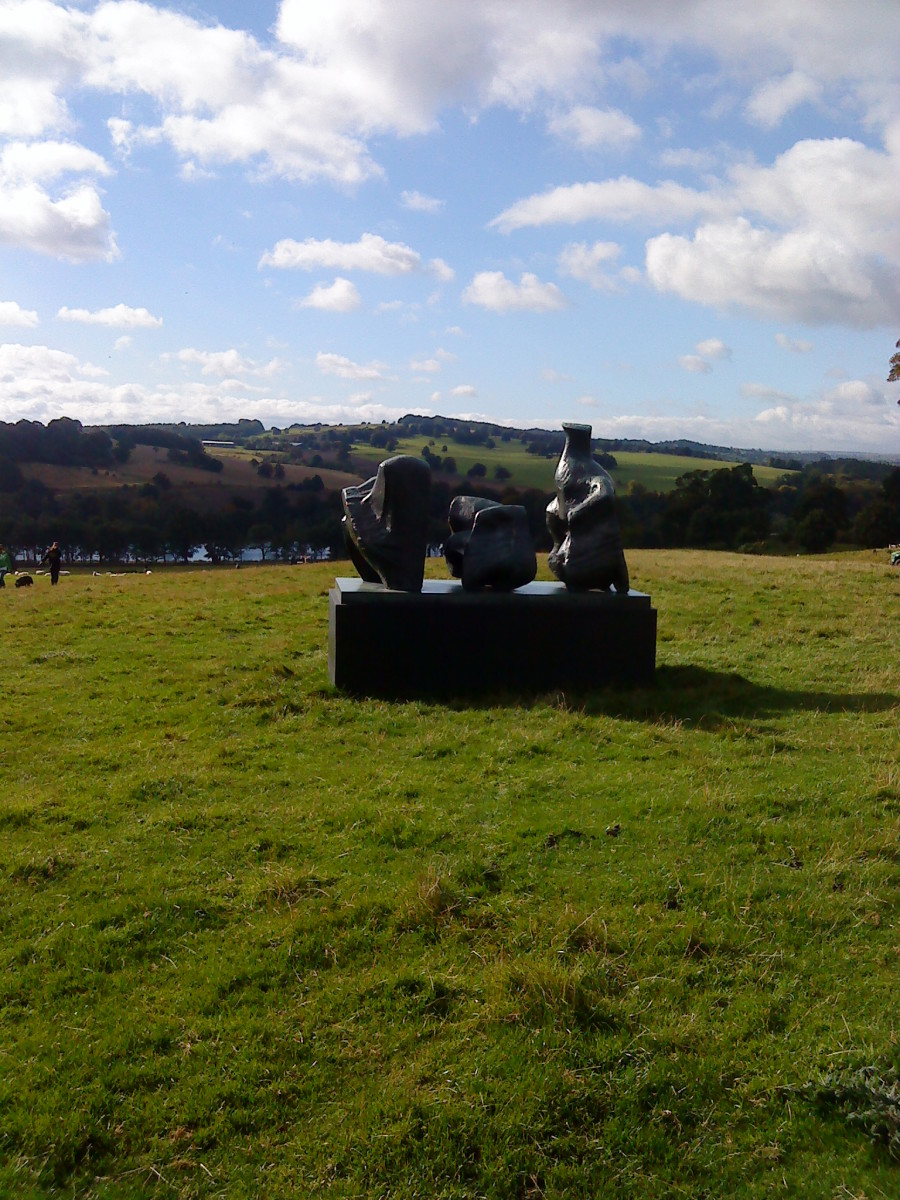 Henry Moore piece, outdoors in a sheep field.