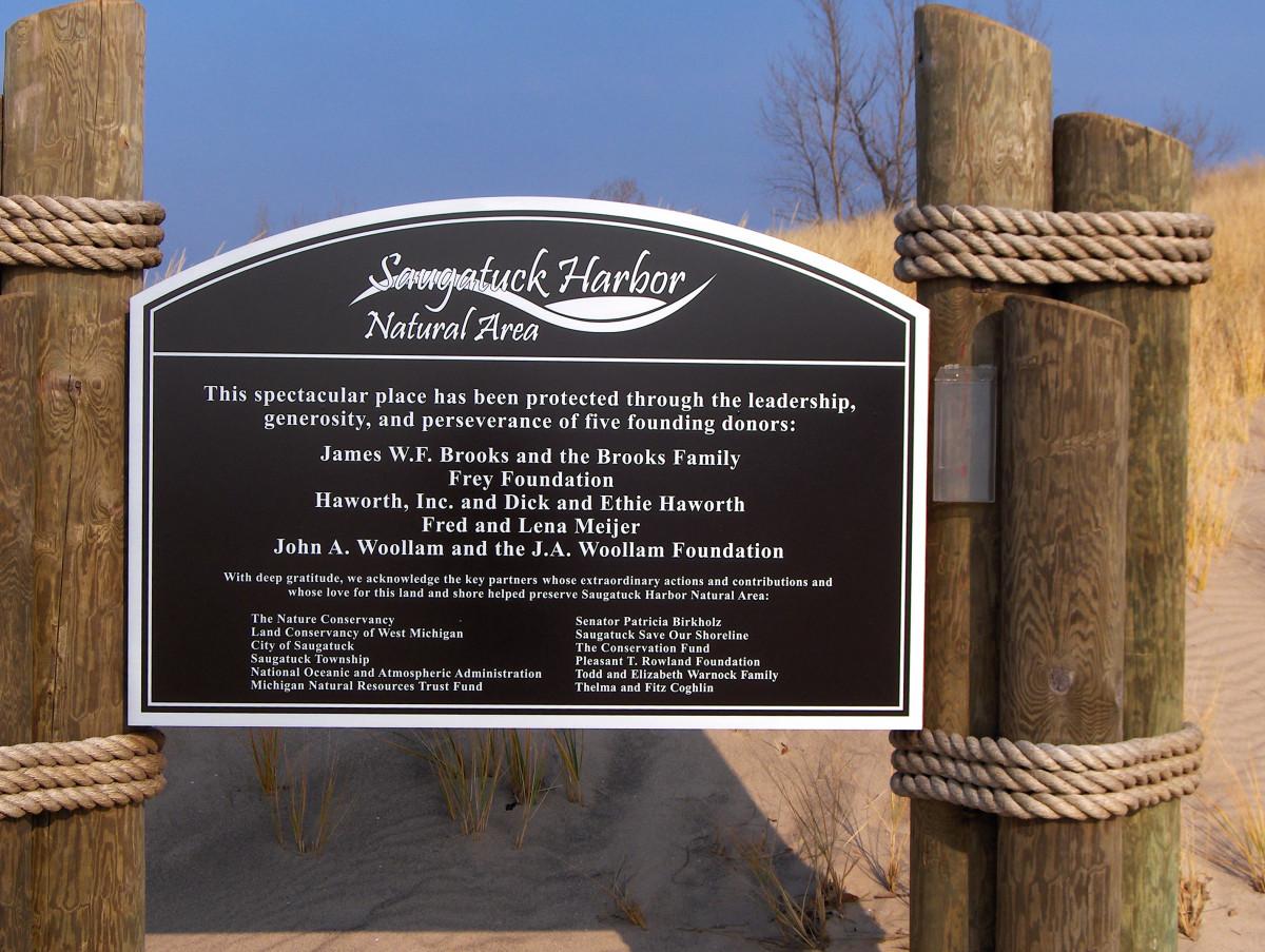 A proud dedication toward community efforts responsible for saving the pristine coastal dune landscape