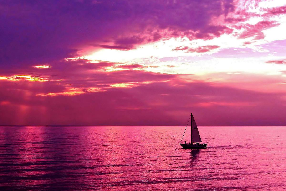Sailing Into the Setting Sun at Oval Beach, Lake Michigan