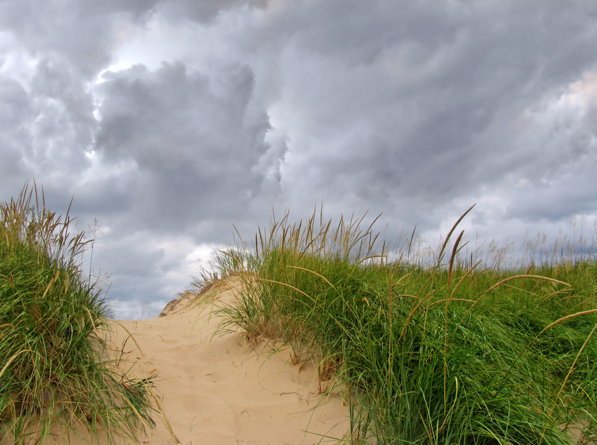 Storm watching over the 40 ft dune between the two main parking lots at Oval Beach.