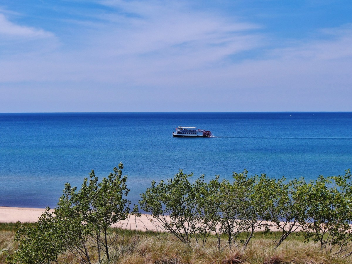 Star of Saugatuck Paddle Boat Cruise Passing by Saugatuck Harbor Natural Area and Oval Beach
