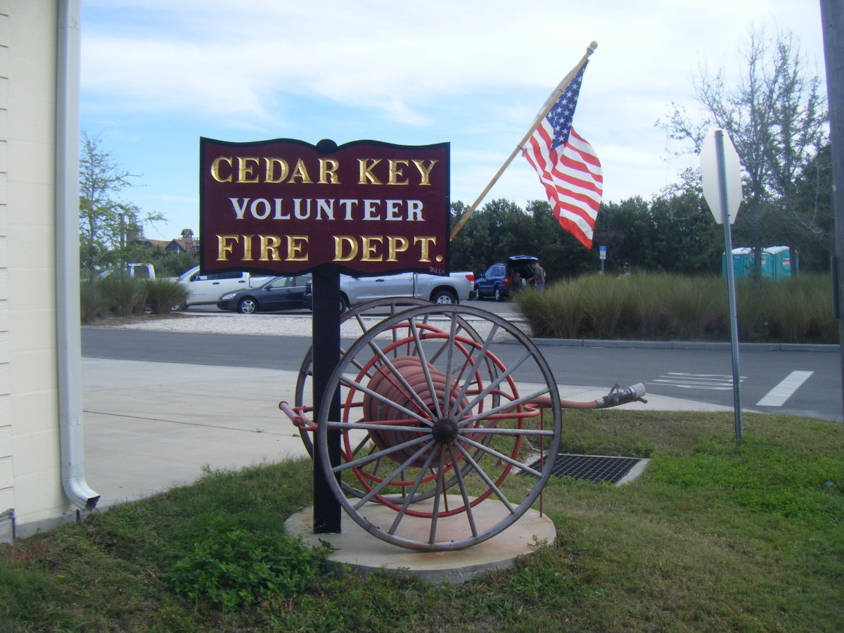 Cedar Key Fire Dept. sign.  The beach there is small but very attractive.  There are numerous restaurants nearby selling seafood and other cuisine, as well as stores and a local museum.