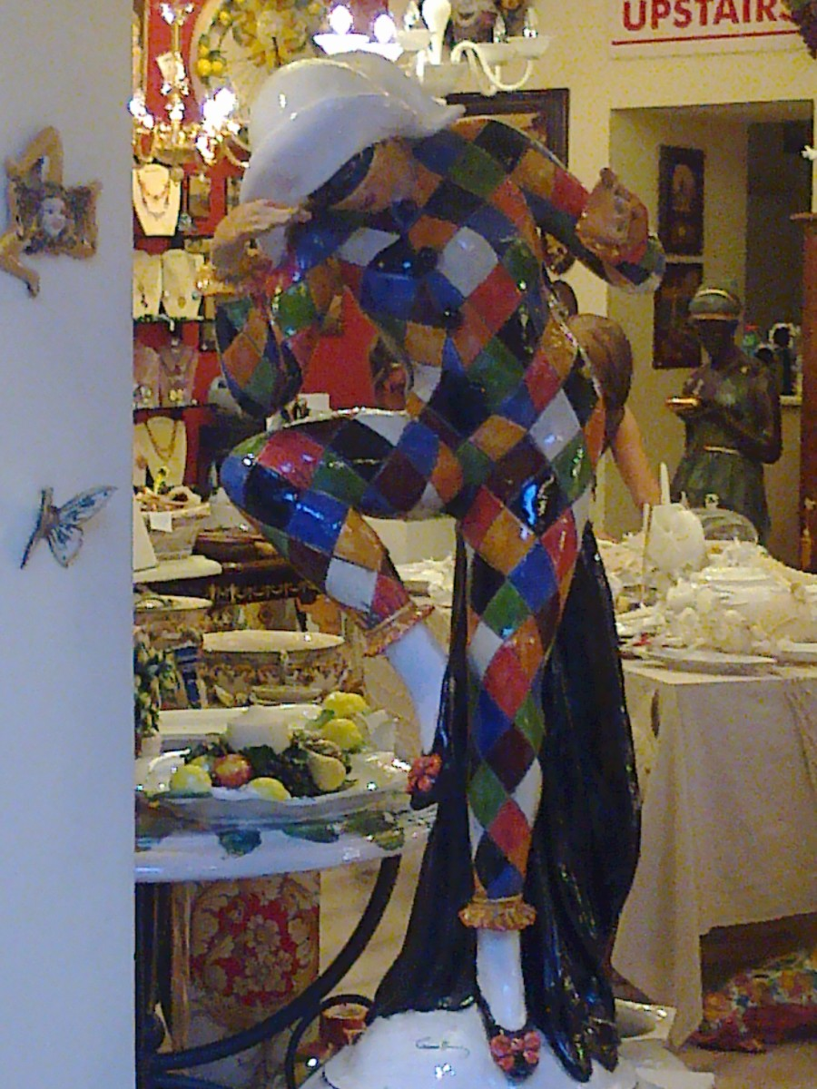 The mischievous Harlequin, one of the stock characters from the Commedia dell'arte, in full-size porcelain