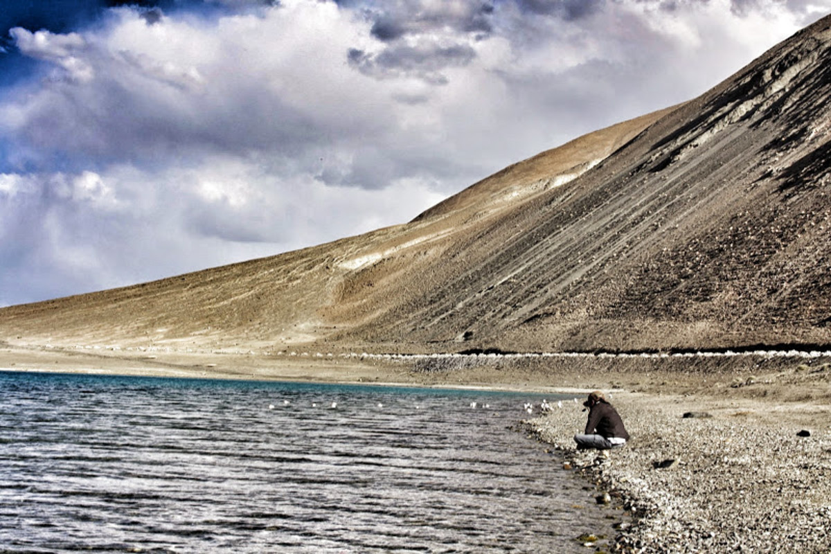 Sitting by The Pangong Tso is such a sublime experience that words fall short of meaning