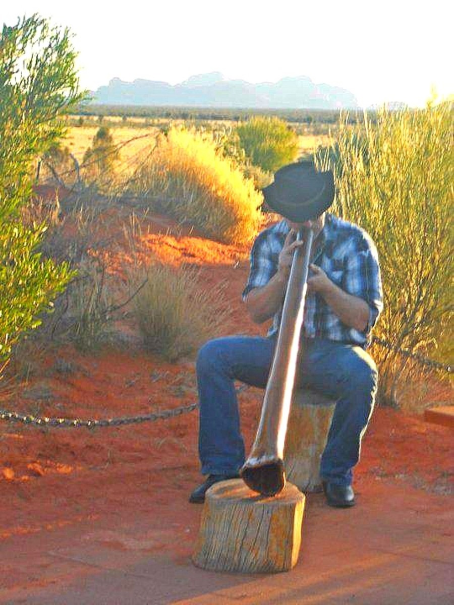 A man plays the Didgeridoo during cocktail hour at Sounds of Silence