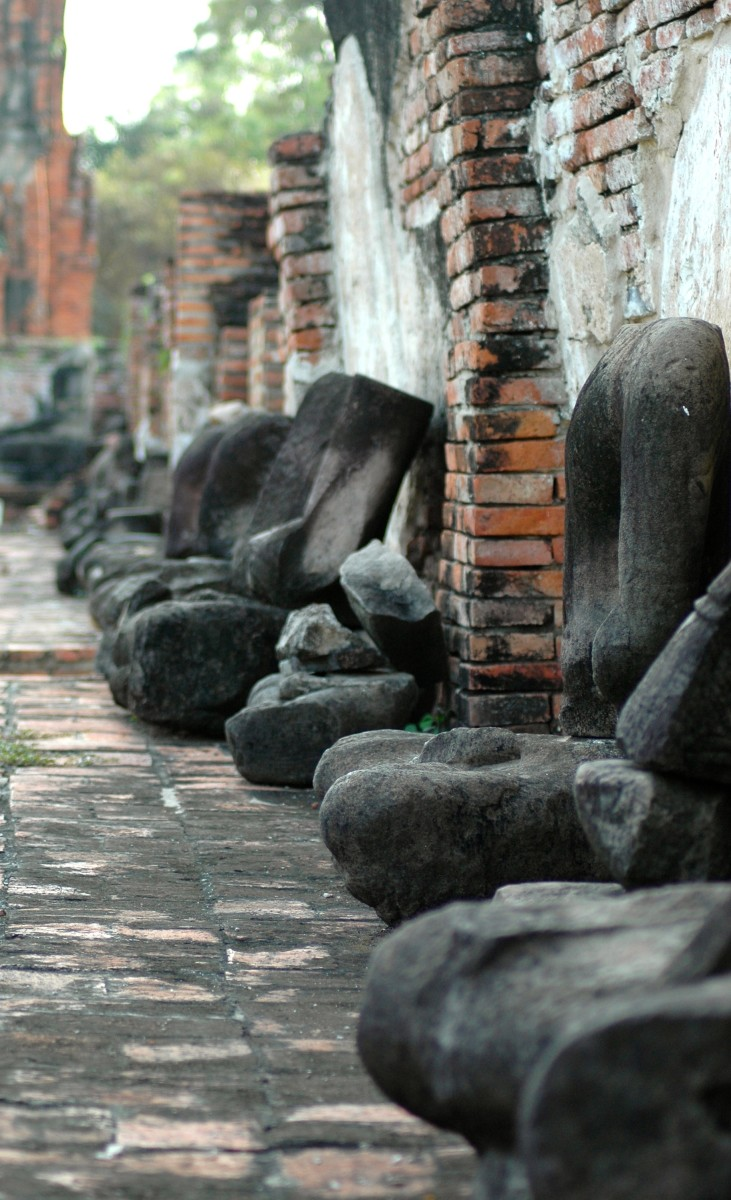 A row of headless buddhas, Thailand