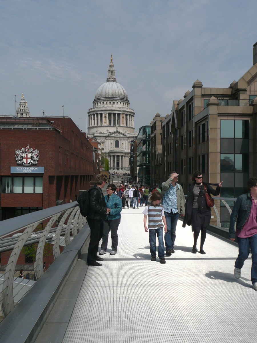 The Millennium Bridge wobbled so badly when it was first opened in 2000, that it had to be closed 2 days later.  The bridge allows people to cross between Tate Modern museum and St. Paul's, which you can see in the picture.
