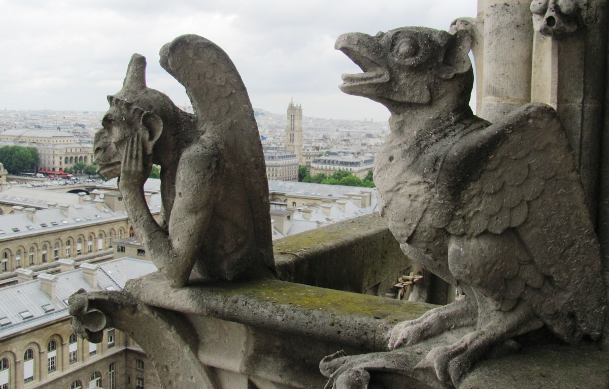 "A panic-stricken Bird Gargoyle calls out behind the Spitting Gargoyle, ""Caw, Caw.""  No response.  He must have stone in his ears."