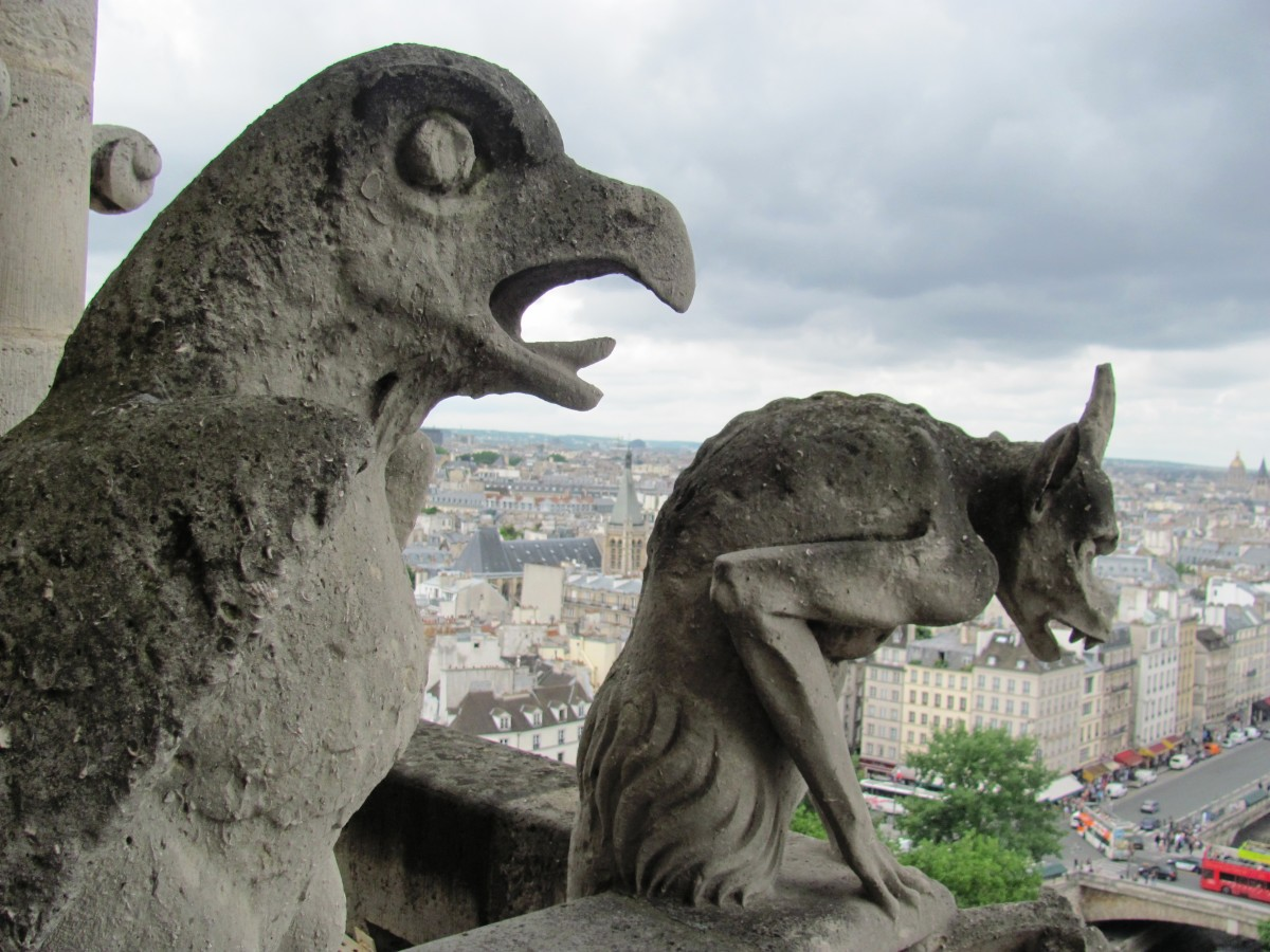 The bird gargoyle here tries in vain to warn tourists that the Paris Pass will not allow them to skip this line.  Perhaps that's what the hyena is laughing about?