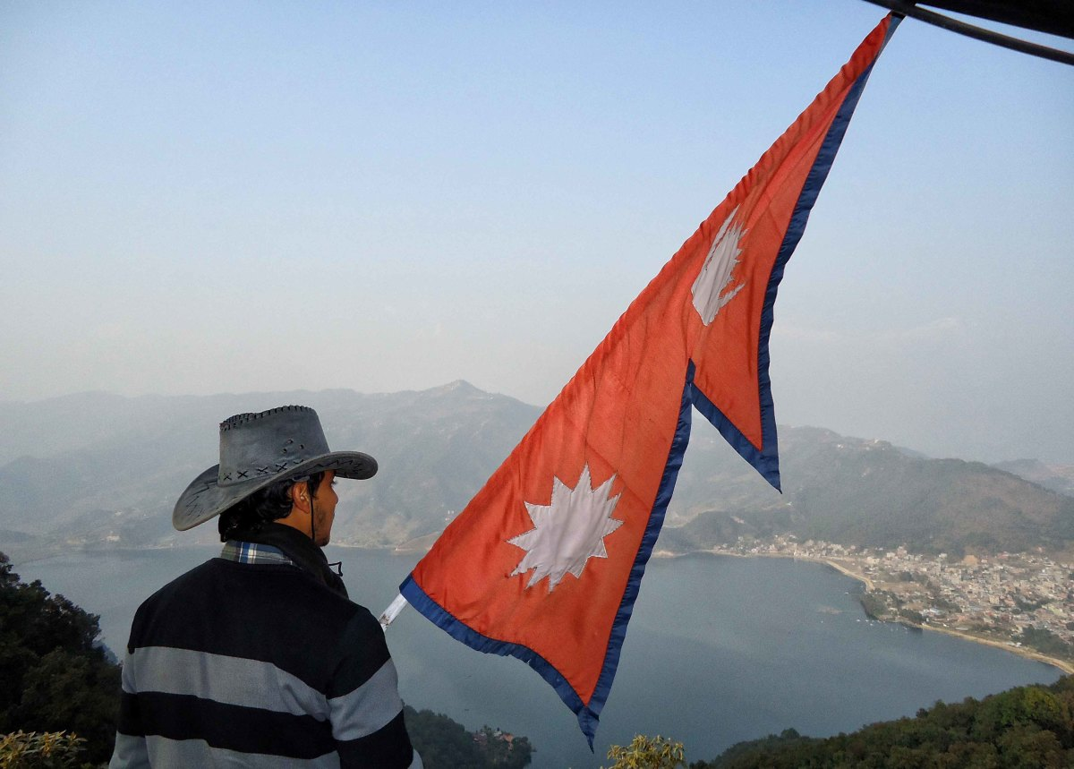 Nepali flag fluttering on the backdrop of Begnas Lake in Pokhara