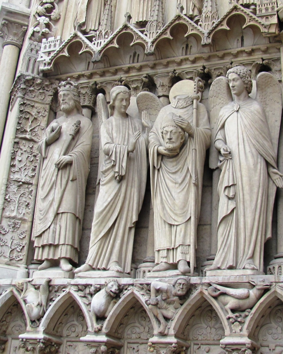 As you enter the cathedral on the left, look for Saint Denis.  Christian tradition says the martyr picked his decapitated head and walked six miles (10 km), preaching the entire way