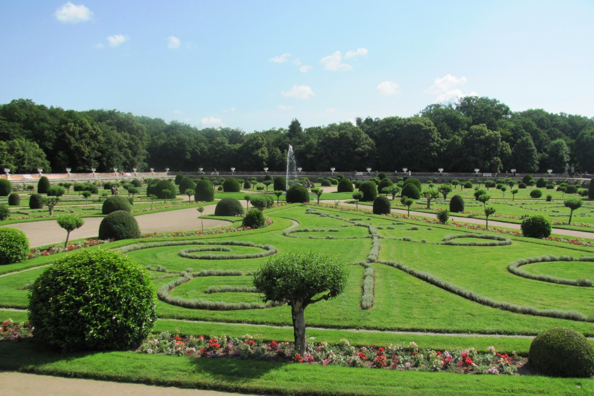The mistress' French gardens consist of eight triangular lawns and a water fountain in the middle.  The raised terraces protect the garden when the Cher River overflows its banks.