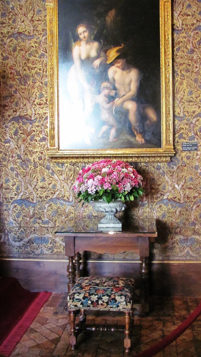 At Catherine de Medici's bedside hangs a masterpiece by Correggio, 16th century Italian Renaissance painter.