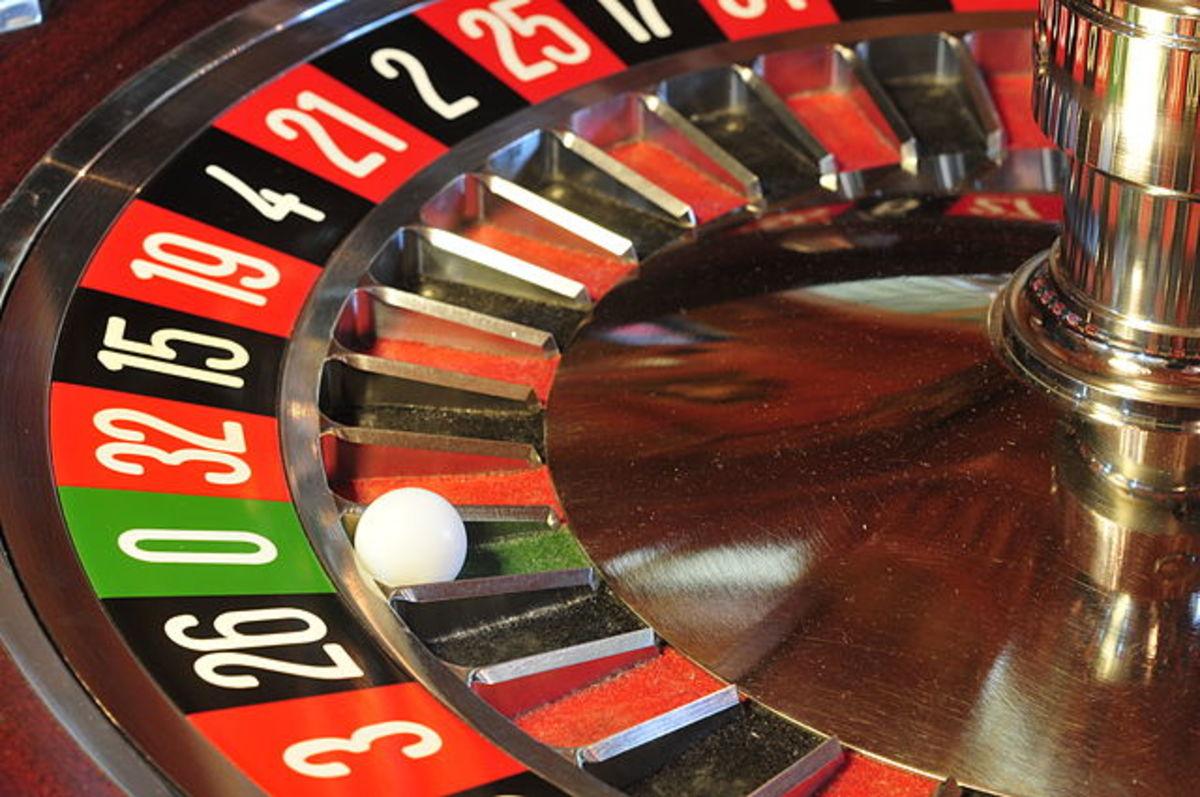 Roulette wheel and single green zero spot.