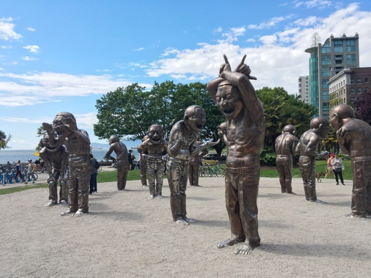 "The ""A-maze-ing Laughter"" sculpture isn't right beside the path but is very close to it on Denman Street. English Bay Beach can be seen in the background of this photo."