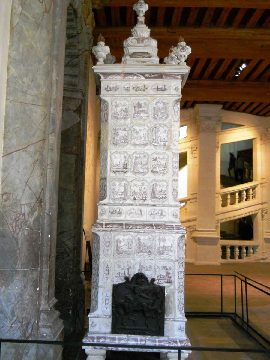 Ornamental wood-fueled fireplaces like this one ineffectively heated the massive castle.