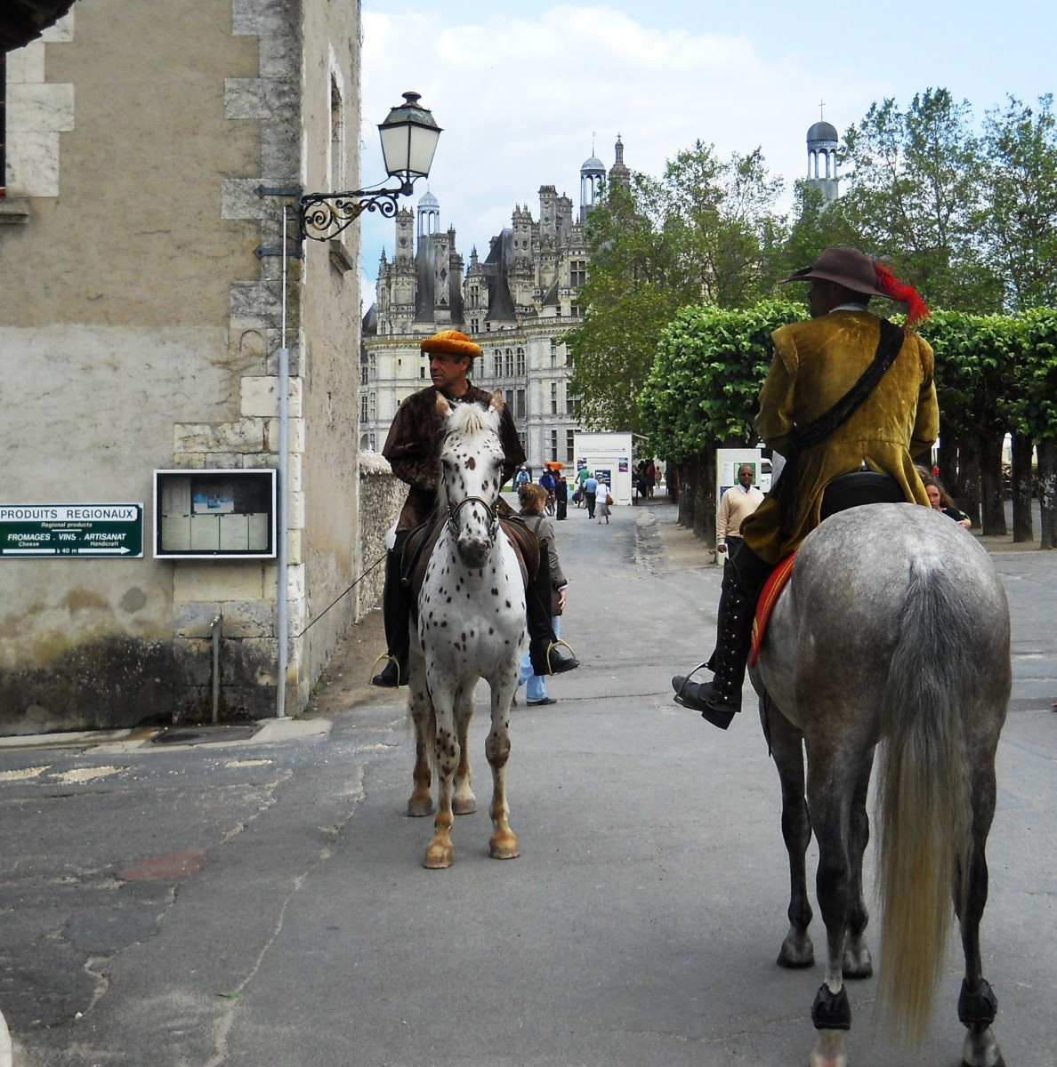 Costumed actors on horseback roam the château property and interact with visitors.