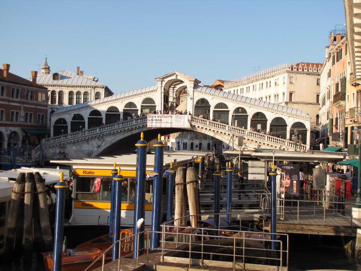 Rialto Vaporetto Station with the Rialto Bridge.