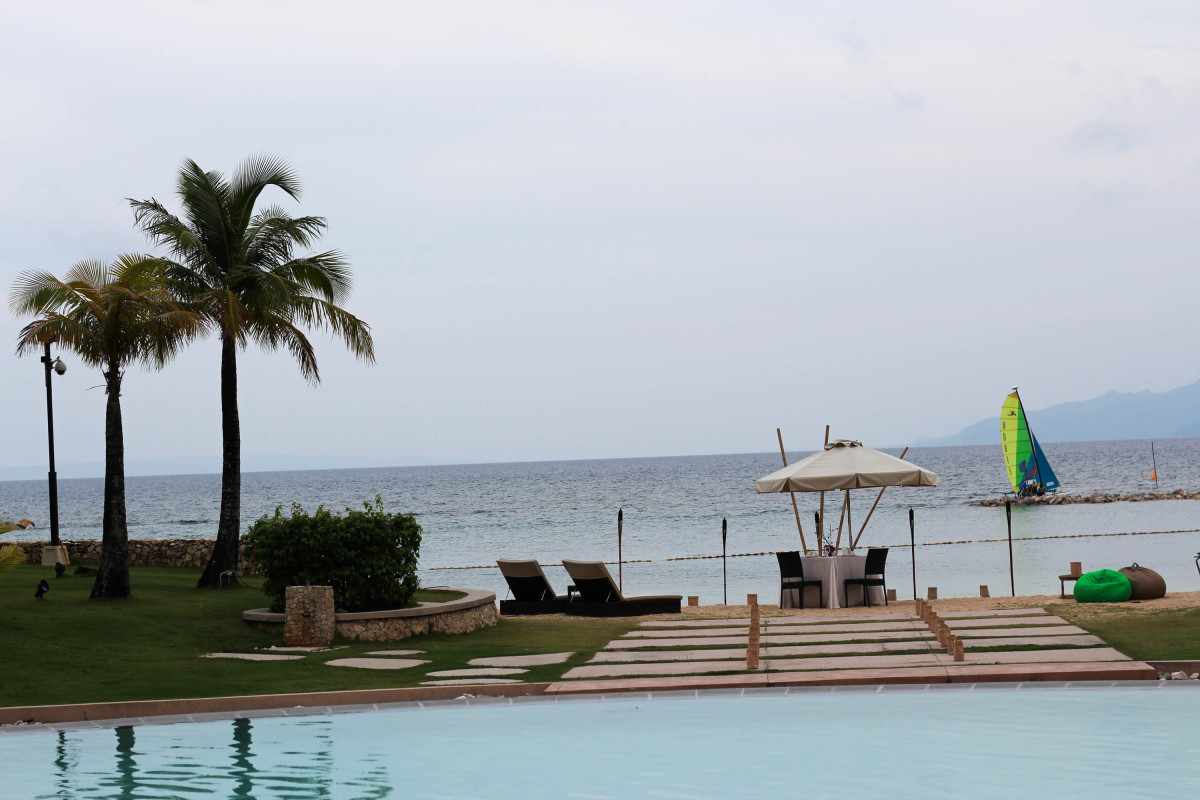 View of the bay (or beach) from the pool side