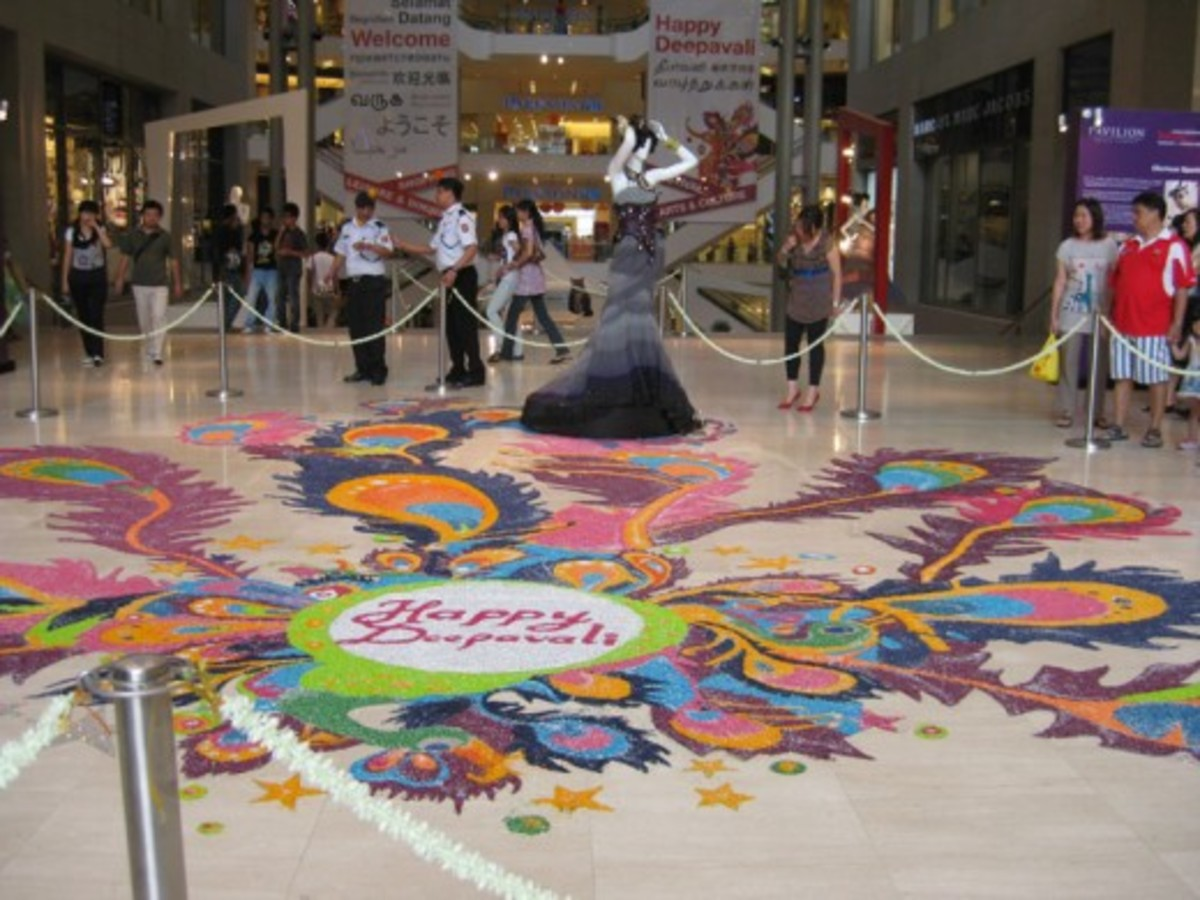 "A Deepavali (Indian ""Christmas"") rice decoration on the floor at the entrance to the Pavilion shopping complex. © 2010 Suzanne Day"