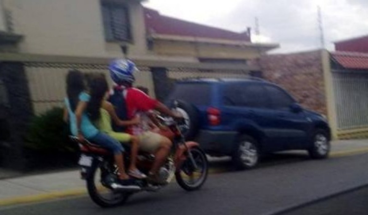 Family of four and just one motorcycle? Pile the entire family on the bike!