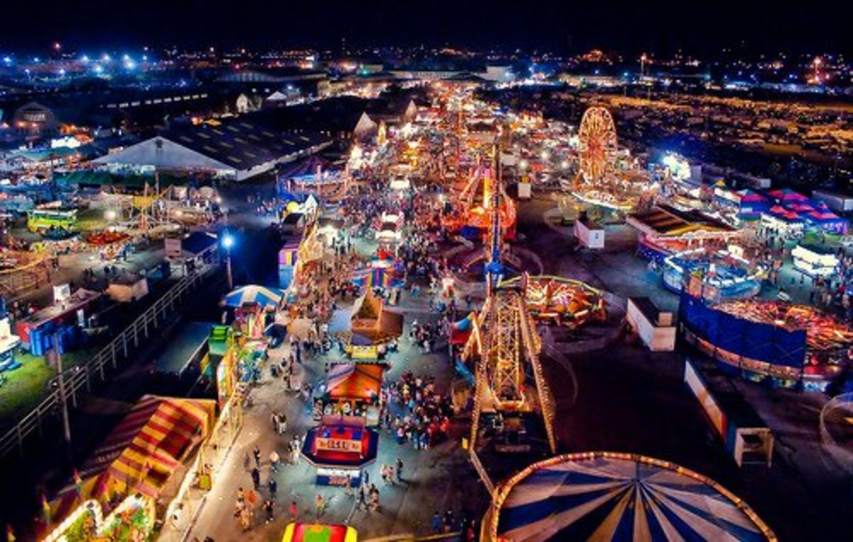 Wow. This may seem like a fantastic amusement park, but it is actually a traveling carnival that will stay on site no more than two weeks before moving to another town. Many foggy childhood memories of amusement parks have turned out to be carnivals.