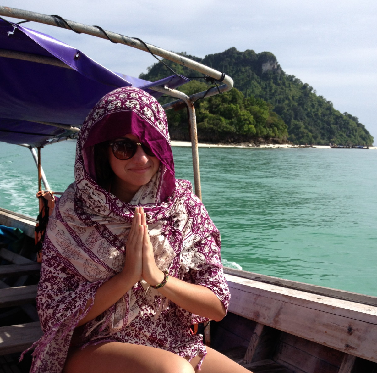 Staying covered up in a taxi boat from Chicken Island back to Krabi after a day in the sun.