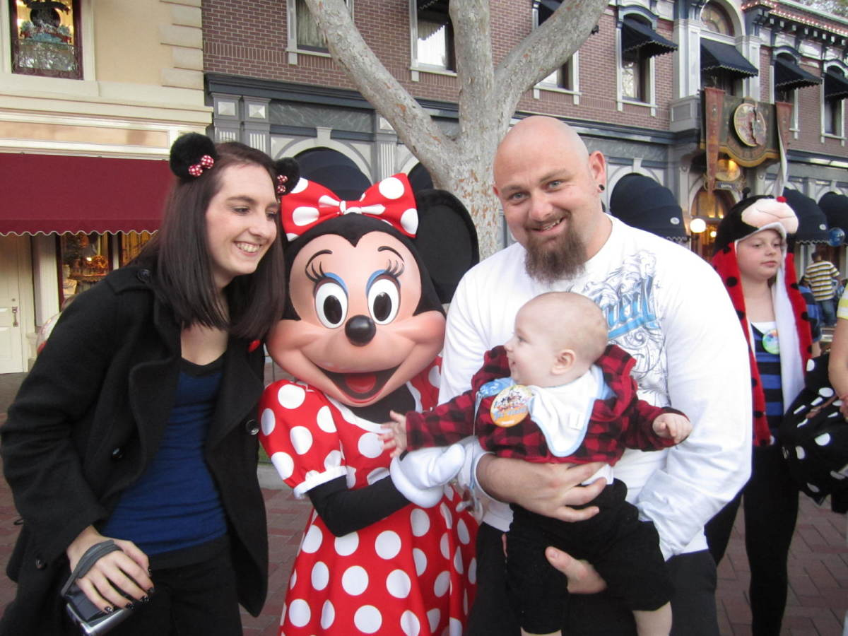 Here is the happy family with Minnie Mouse and of course baby Ty flirting with her!