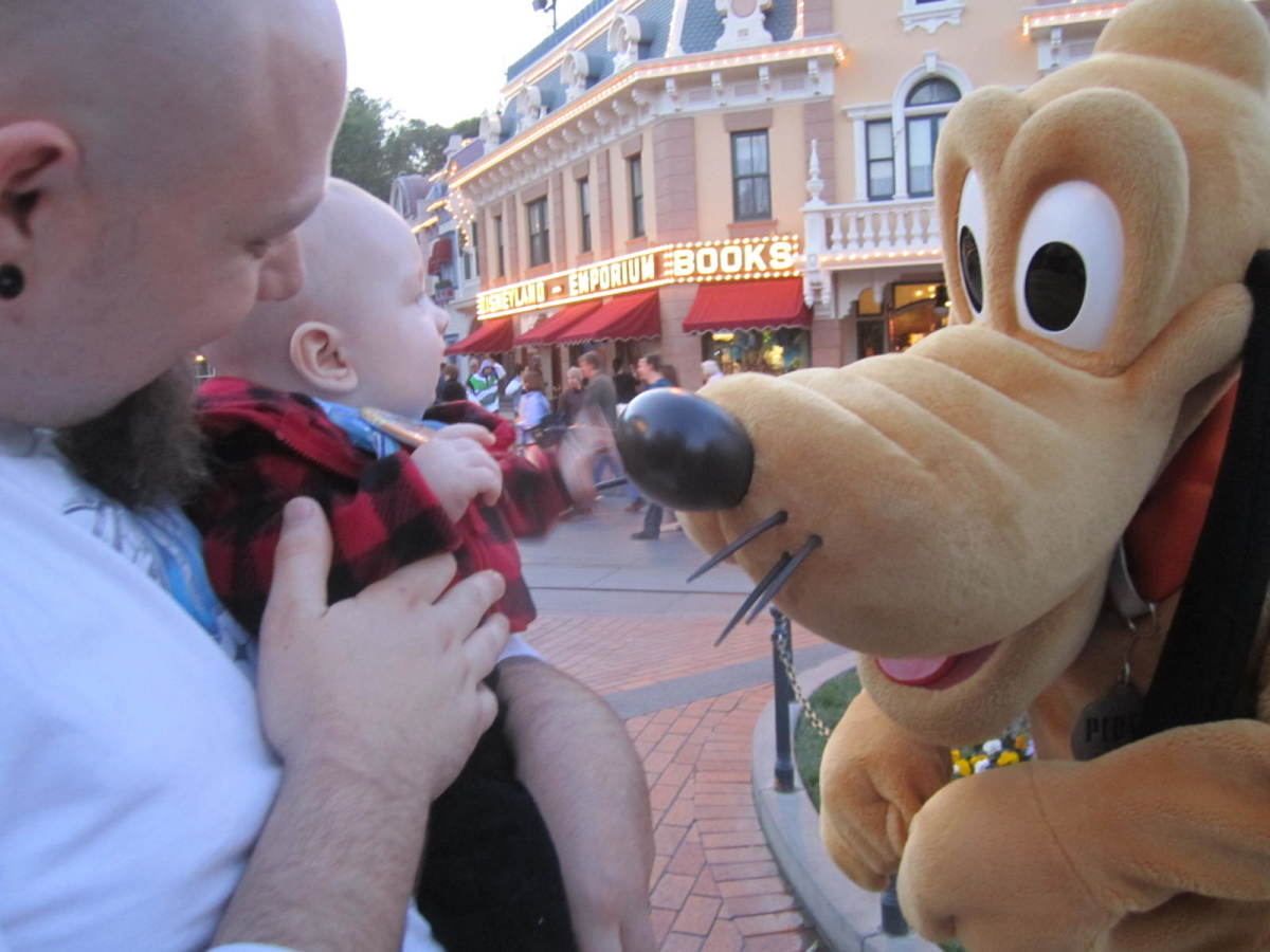 Daddy and baby playing with Pluto!