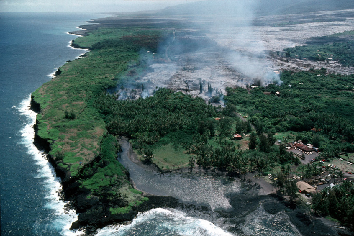 Aerial view of lava advancing down the slope toward Kalapana Village and Kaimu Bay.