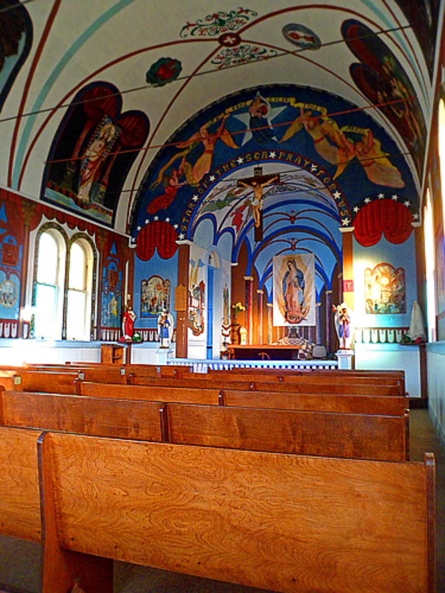 Colorful murals and paintings cover much of the church interior.