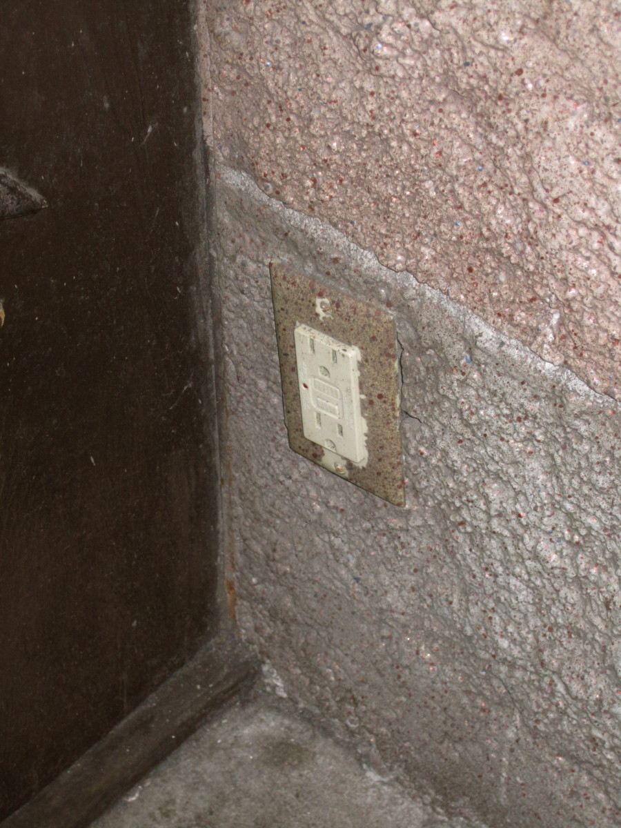 Here is the outlet. It is on the inside wall of a doorway.