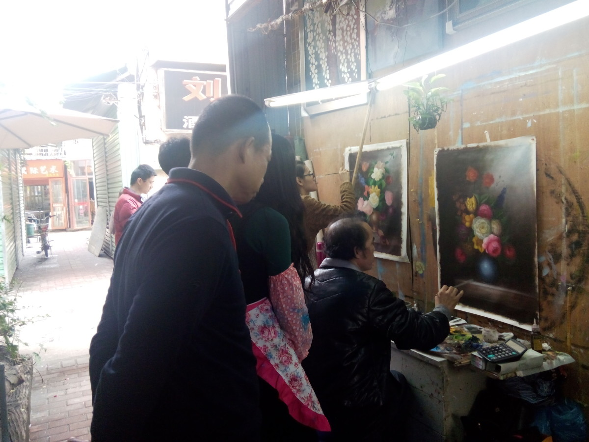 Artists painting in Dafen Arts Village, Shenzhen, China