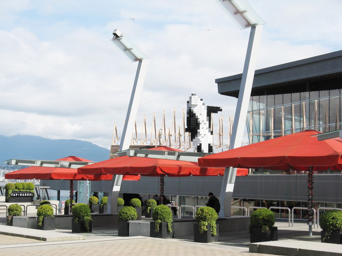 The digital orca sculpture by Douglas Coupland is located next to the west building of the Vancouver Convention Centre