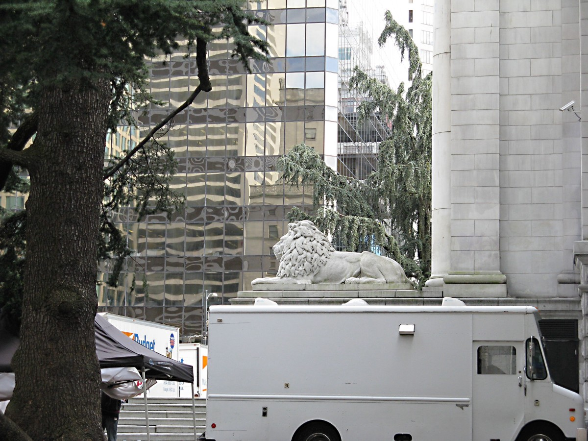 A stone lion watches the movie crew
