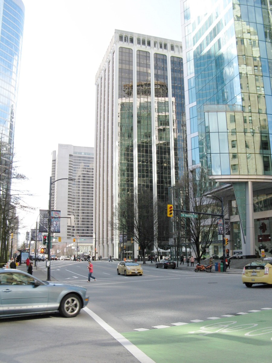A downtown scene, with a green bicycle lane in the foreground