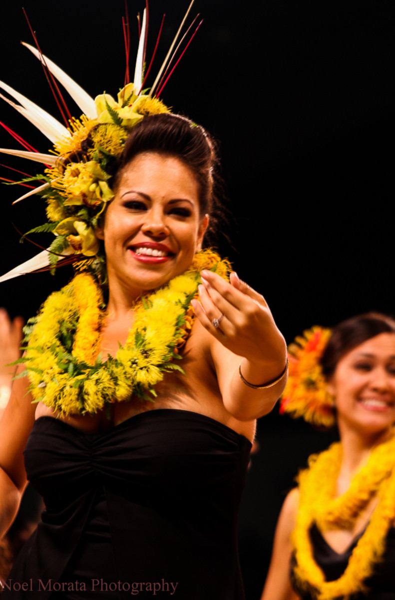 Dancers adorn themselves with flowers in every hula at the Merrie Monarch Festival.