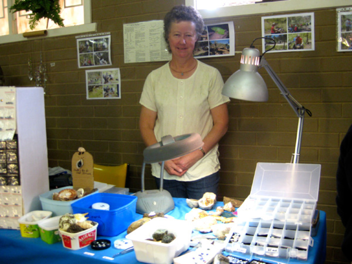 Margaret Holmes, the Club's field trip officer, with her collection of found rocks, shells and gems.