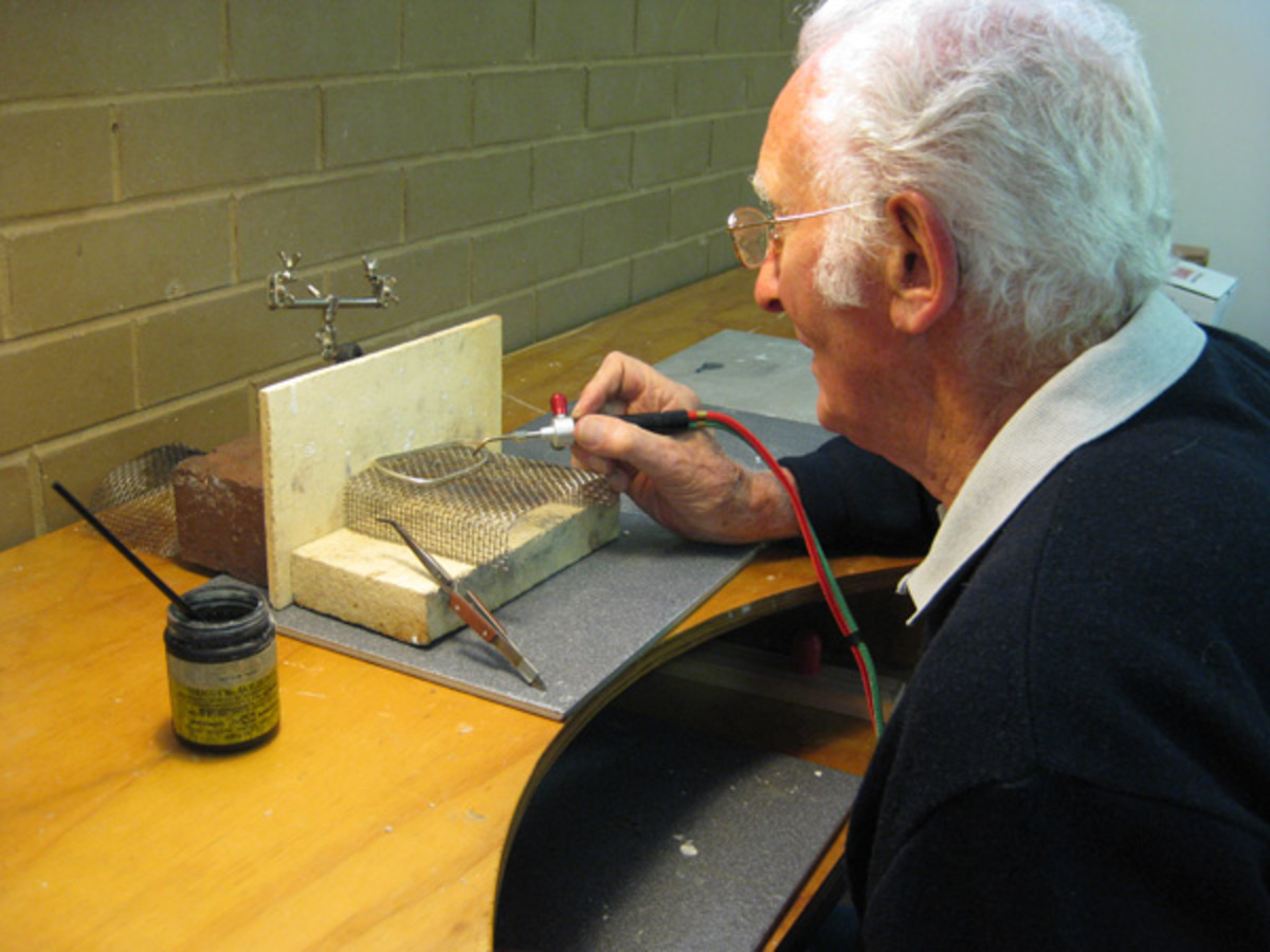 Workshop officer Leo demonstrates silver smithing in a previous exhibition.